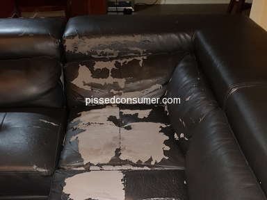 Rooms To Go - Flaking leather sofa
