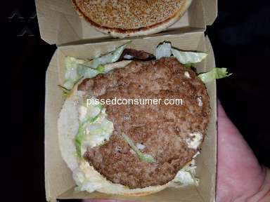 Mcdonalds - McDonald's Employee took a bite of burger