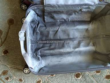 Samsonite - Black wheel residue ruining clothes in carry-on