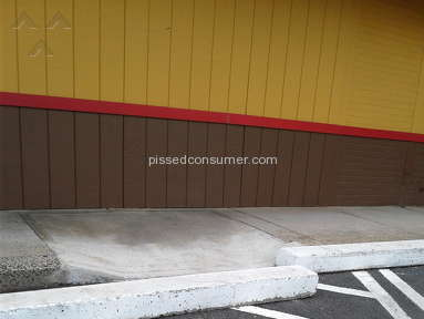 Popeyes Louisiana Kitchen -  Wheelchair incline blocked by cement block lay week and outs still blocked as of yesterday.