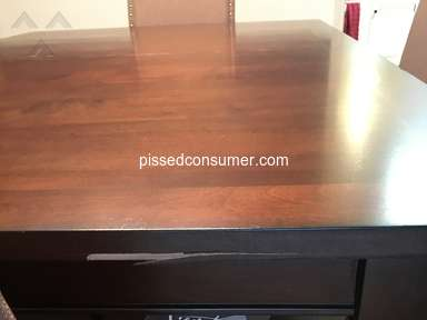 Ashley Furniture - Received Damaged Dining Room Table