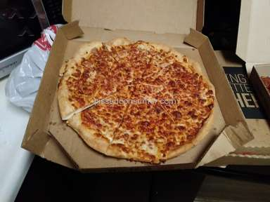 Pizza Hut - Cold and burned pizza delivered.