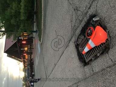 Potholes in parking lot at Smokey Bones, Reynoldsburg, Ohio on Brice Rd.