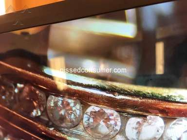 Fred Meyer Jewelers - Diamonds falling out and loose everywhere