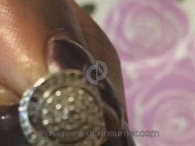 Macys - Diamond fell out of earrings after one week of wearing them
