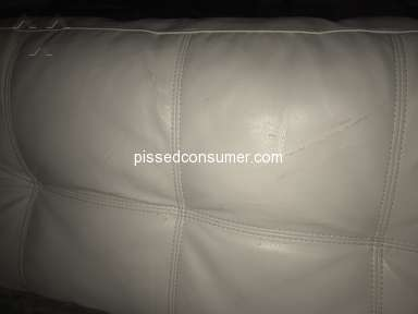 El Dorado Furniture - White leather and faux leather couch peeling.